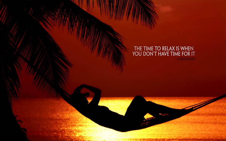 Picture of person lying on hammock by the sea at sunset with quote the time to relax is when you don't have time for it