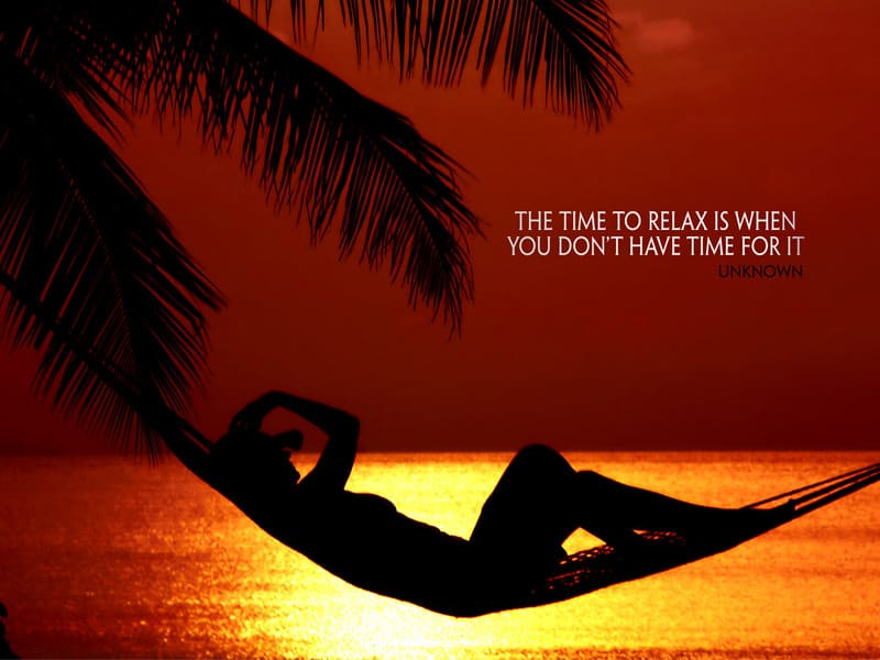 The time to relax is when you don't have time for it - quote on photo of person lying on hammock against sunset at the sea